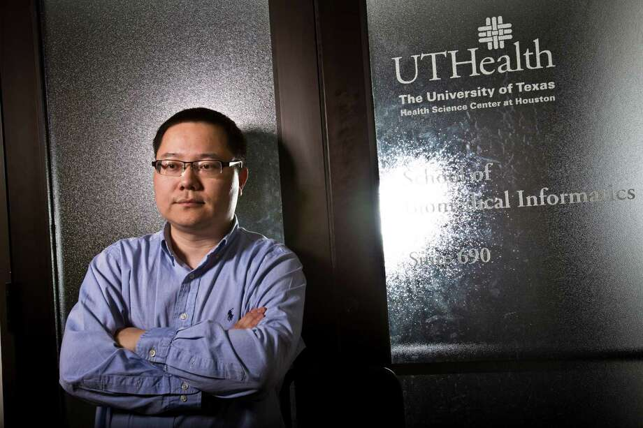 The University of Texas Health Science Center at Houston recruited Hua Xu last fall with the promise of a grant from the state cancer agency, but the moratorium has put his research project on ice. Photo: Eric Kayne / © 2013 Eric Kayne