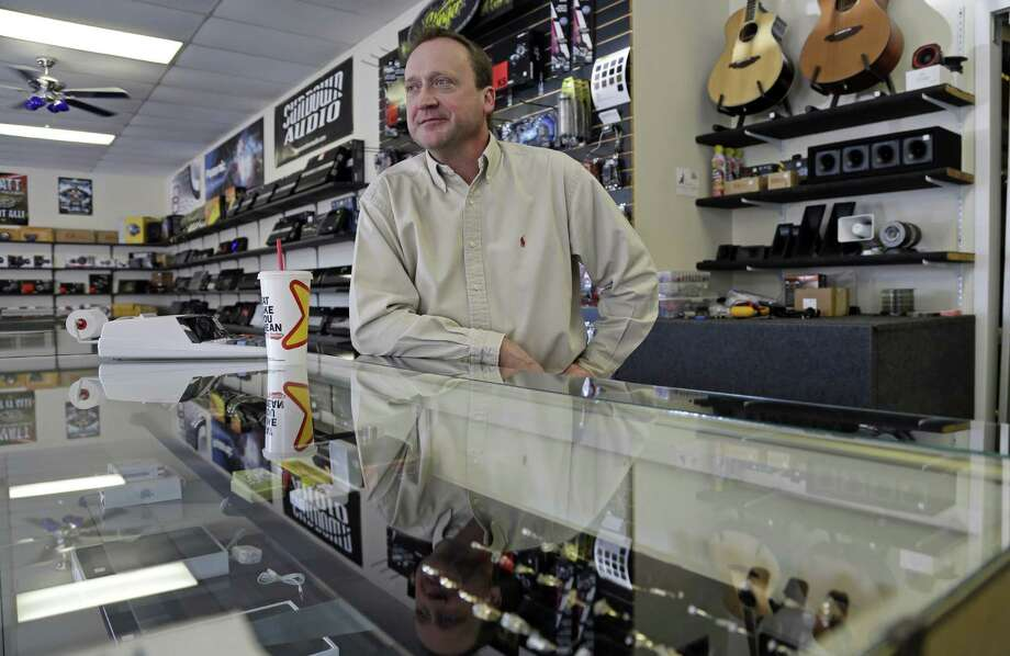 In Fayetteville, N.C., Tom Raper is owner of Bragg Pawn Shop, located near a main entrance to Fort Bragg. Business owners in town are anticipating the sequestration to have a negative effect on sales. Photo: Gerry Broome / Associated Press