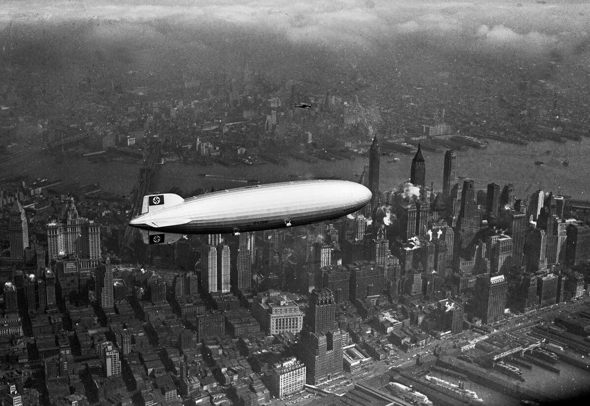 The German zeppelin Hindenburg flies over Manhattan on May 6, 1937. A few hours later, the ship burst into flames in an attempt to land at Lakehurst, N.J.