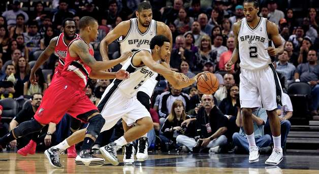 Cory Joseph starts the break as the Spurs play the Portland Trail Blazers at the AT&T Center on March 8, 2013. Photo: TOM REEL