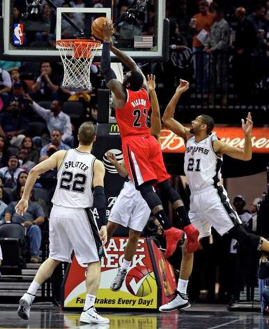 J.J. Hickson slips in for a dunk in the first half for the Trail Blazers as the Spurs play the Portland Trailblazers at the AT&T Center on March 8, 2013. Photo: TOM REEL