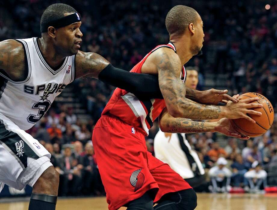 Stephen Jackson tries for a steal as the Spurs play the Portland Trail Blazers at the AT&T Center on March 8, 2013. Photo: TOM REEL