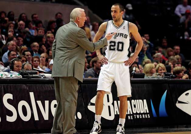 Greg Popovich gives team instructions to Manu Ginobili as the Spurs play the Portland Trail Blazers at the AT&T Center on March 8, 2013. Photo: TOM REEL
