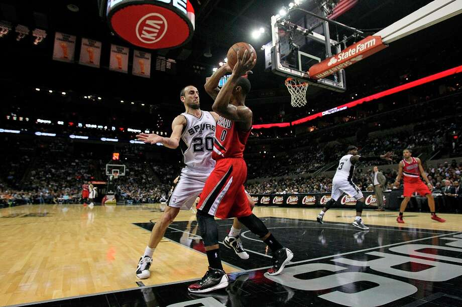 Manu Ginobili defends against the inbounds pass on the baseline as the Spurs play the Portland Trail Blazers at the AT&T Center on March 8, 2013. Photo: TOM REEL
