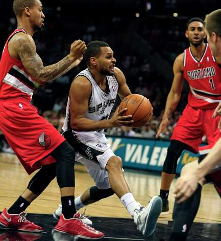 Patty Mills draws a crowd in the lane as the Spurs play the Portland Trail blazers at the AT&T Center on March 8, 2013. Photo: TOM REEL
