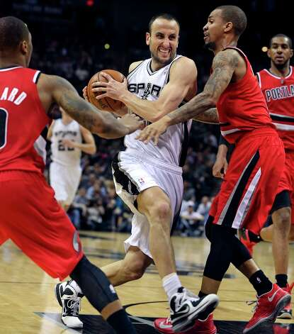 Manu Ginobili tractors into the lane as the Spurs play the Portland Trail Blazers at the AT&T Center on March 8, 2013. Photo: TOM REEL