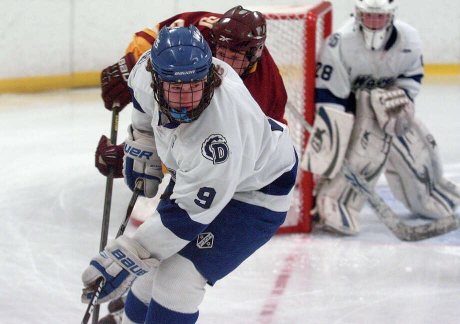 Darien's Dana Wensberg in action as Darien and St. Joseph High Schools face off in the Division 1 Boys Hockey quarterfinals at Terry Connors Ice Rink in Stamford, Conn., March 9, 2013. Photo: Keelin Daly / Keelin Daly