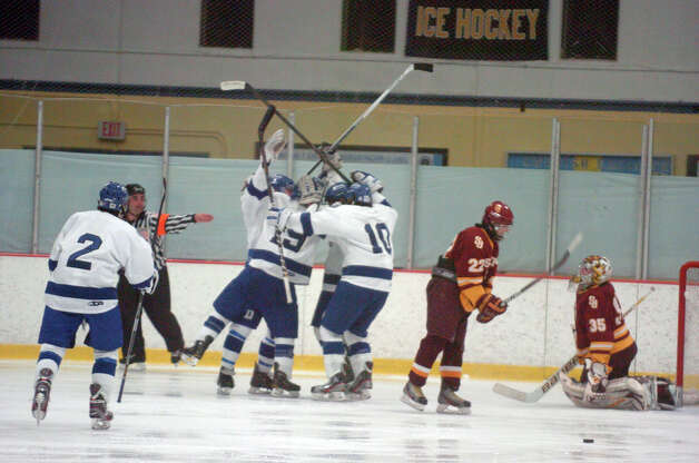 The Blue Wave celebrates after scoring as Darien and St. Joseph High Schools face off in the Division 1 Boys Hockey quarterfinals at Terry Connors Ice Rink in Stamford, Conn., March 9, 2013. Photo: Keelin Daly / Keelin Daly