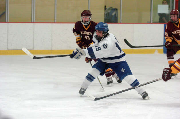 Darien's Robbie Juterbock fires as Darien and St. Joseph High Schools face off in the Division 1 Boys Hockey quarterfinals at Terry Connors Ice Rink in Stamford, Conn., March 9, 2013. Photo: Keelin Daly / Keelin Daly