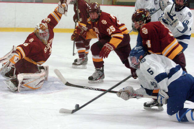 Darien's Owen Koorbusch and St. Joseph's Filippo Petrini battle as Darien and St. Joseph High Schools face off in the Division 1 Boys Hockey quarterfinals at Terry Connors Ice Rink in Stamford, Conn., March 9, 2013. Photo: Keelin Daly / Keelin Daly