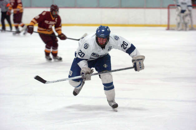 Darien's Trent Bergin in action as Darien and St. Joseph High Schools face off in the Division 1 Boys Hockey quarterfinals at Terry Connors Ice Rink in Stamford, Conn., March 9, 2013. Photo: Keelin Daly / Keelin Daly