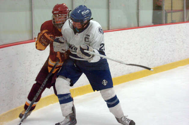 Darien's Trent Bergin and St. Joseph's Dan Castorino in action as Darien and St. Joseph High Schools face off in the Division 1 Boys Hockey quarterfinals at Terry Connors Ice Rink in Stamford, Conn., March 9, 2013. Photo: Keelin Daly / Keelin Daly