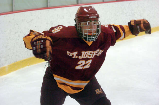 St. Joseph's Dan Castorino defends despite dropping his stick as Darien and St. Joseph High Schools face off in the Division 1 Boys Hockey quarterfinals at Terry Connors Ice Rink in Stamford, Conn., March 9, 2013. Photo: Keelin Daly / Keelin Daly