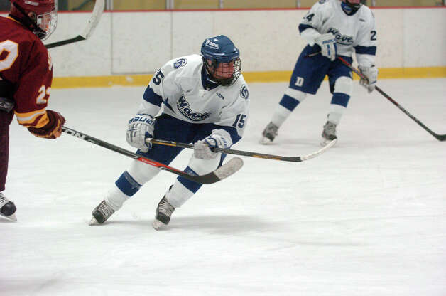 Darien's Nick Bruno in action as Darien and St. Joseph High Schools face off in the Division 1 Boys Hockey quarterfinals at Terry Connors Ice Rink in Stamford, Conn., March 9, 2013. Photo: Keelin Daly / Keelin Daly