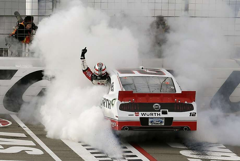 Sam Hornish Jr. waves to fans as he hangs out his window while doing a burnout after winning the NASCAR Nationwide Series auto race, Saturday, March 9, 2013 in Las Vegas. (AP Photo/Julie Jacobson) Photo: Julie Jacobson, Associated Press