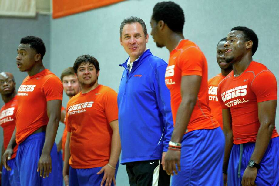Houston Baptist football coach Vic Shealy, center, is all smiles during a workout as he prepares his players for the start of the program's inaugural spring practice March 19. Photo: Brett Coomer, Staff / © 2013 Houston Chronicle