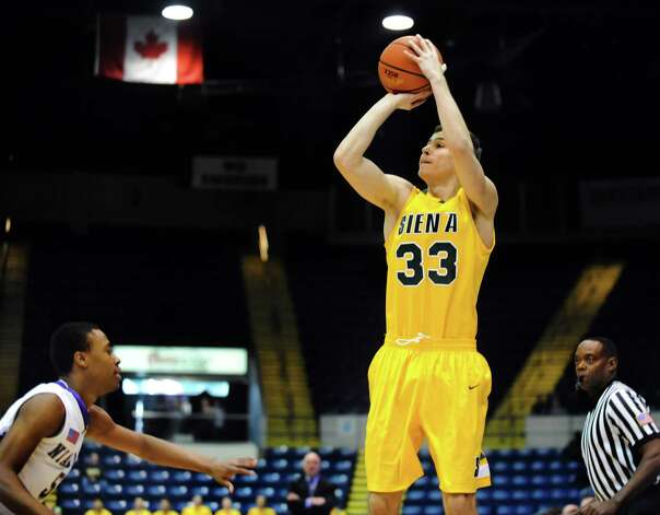 Siena's Rob Poole (33), center, shoots for three points during their quarterfinal MAAC Championship basketball game against Niagara on Saturday, March 9, 2013, at MassMutual Center in Springfield, Mass. (Cindy Schultz / Times Union) Photo: Cindy Schultz / 10021492A