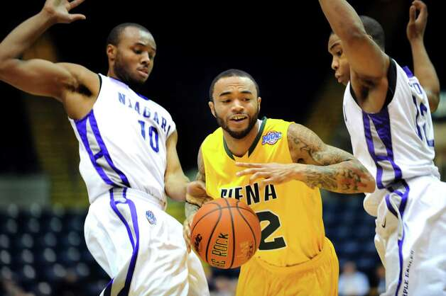 Siena's Rakeem Brookins (12), center, gets pressure from Niagara's Juan'ya Green (10), left, and Marvin Jordan (32) during their quarterfinal MAAC Championship basketball game on Saturday, March 9, 2013, at MassMutual Center in Springfield, Mass. (Cindy Schultz / Times Union) Photo: Cindy Schultz / 10021492A