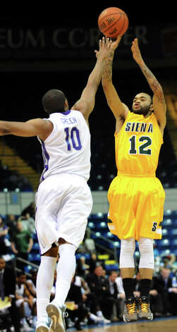 Siena's Rakeem Brookins (12), right, shoots for three points as Niagara's Juan'ya Green (10) defends during their quarterfinal MAAC Championship basketball game on Saturday, March 9, 2013, at MassMutual Center in Springfield, Mass. (Cindy Schultz / Times Union) Photo: Cindy Schultz / 10021492A
