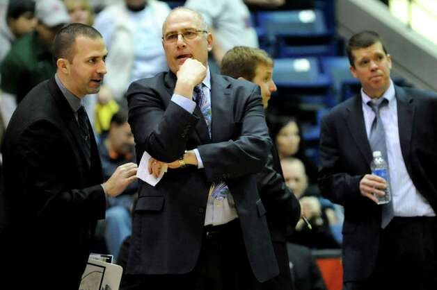 Siena's coach Mitch Buonaguro, center, confers with his assistant coaches during their quarterfinal MAAC Championship basketball game against Niagara on Saturday, March 9, 2013, at MassMutual Center in Springfield, Mass. (Cindy Schultz / Times Union) Photo: Cindy Schultz / 10021492A