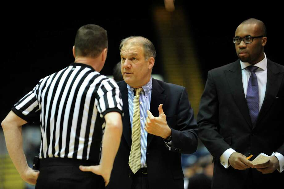 Niagara's coach Joe Mihalich, center, talks with an official during their quarterfinal MAAC Championship basketball game against Siena on Saturday, March 9, 2013, at MassMutual Center in Springfield, Mass. (Cindy Schultz / Times Union) Photo: Cindy Schultz / 10021492A