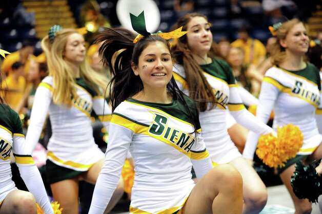 Siena cheerleaders fire up the crowd during a break in the quarterfinal MAAC Championship basketball game against Niagara on Saturday, March 9, 2013, at MassMutual Center in Springfield, Mass. (Cindy Schultz / Times Union) Photo: Cindy Schultz / 10021492A