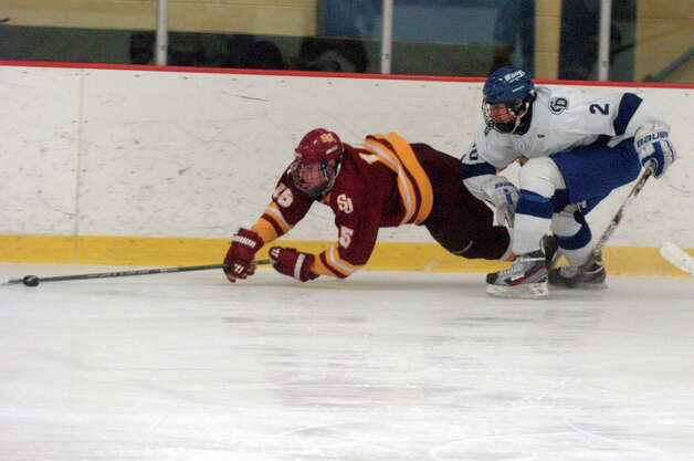 Darien's Nick Allam draws a penalty as he and St. Joseph's Ryan Corcoran battle as Darien and St. Joseph High Schools face off in the Division 1 Boys Hockey quarterfinals at Terry Connors Ice Rink in Stamford, Conn., March 9, 2013. Photo: Keelin Daly / Keelin Daly