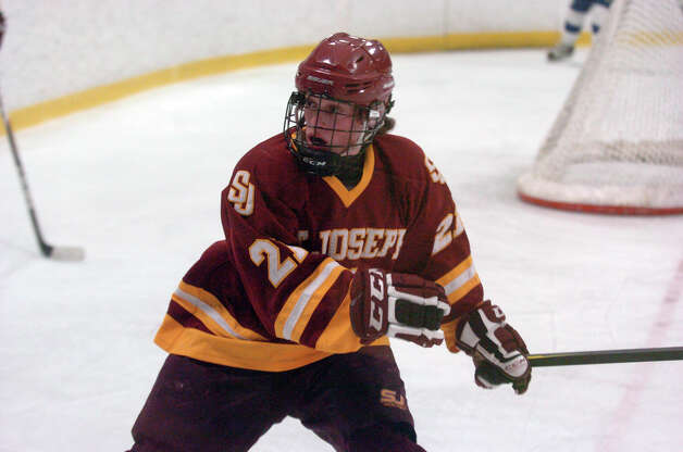 St. Joseph's Matt Greenhut moves along the boards as Darien and St. Joseph High Schools face off in the Division 1 Boys Hockey quarterfinals at Terry Connors Ice Rink in Stamford, Conn., March 9, 2013. Photo: Keelin Daly / Keelin Daly