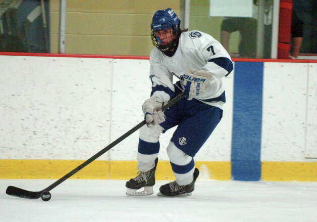 Darien's Jack Knowlton in action as Darien and St. Joseph High Schools face off in the Division 1 Boys Hockey quarterfinals at Terry Connors Ice Rink in Stamford, Conn., March 9, 2013. Photo: Keelin Daly / Keelin Daly