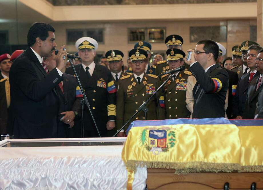 Venezuela Vice President Jorge Arreaza (right), late President Hugo Chávez's son-in-law, is sworn in during Chávez's funeral. Photo: AFP / Getty Images