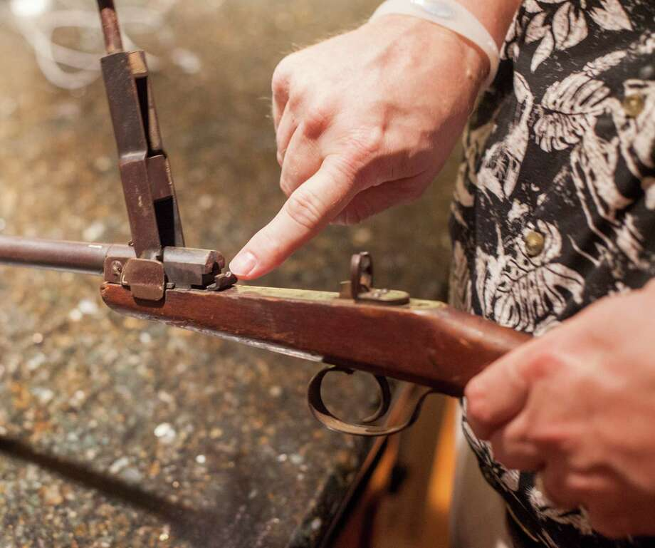 Richard Wilson's heirloom rifle has not been fired since he was a boy. The Wilsons have a gun for protection, but they store it and bullets in separate rooms. Photo: BEN SKLAR, STR / NYTNS
