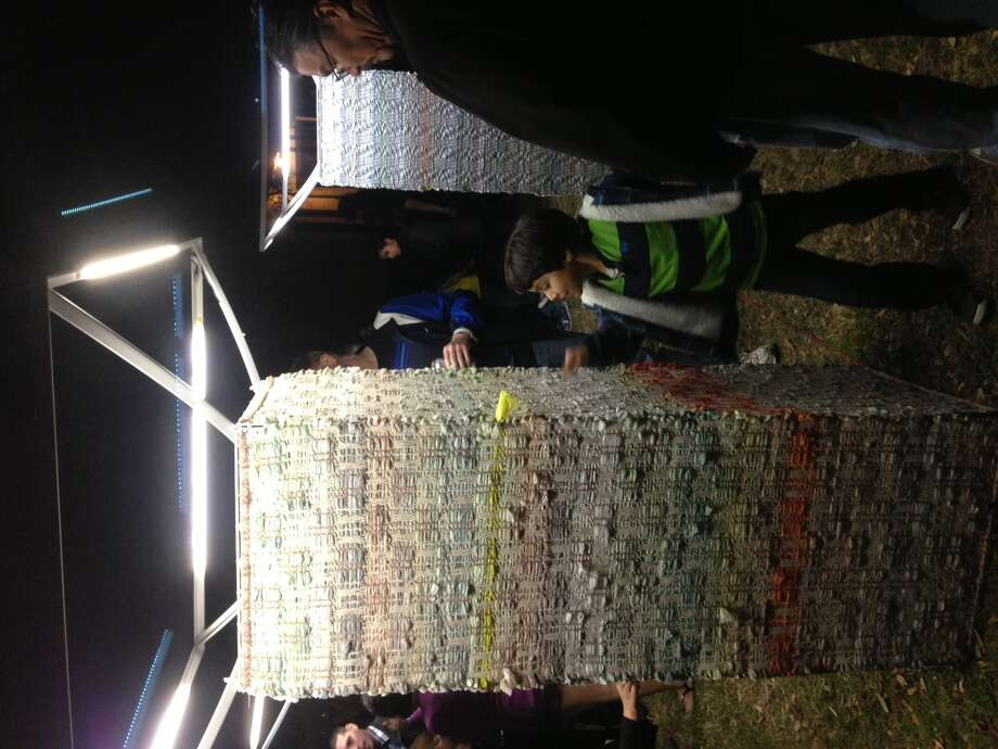 A new take on old newspaper bags is seen during Luminaria on Saturday, March 9, 2013. Photo: Emily Spicer / San Antonio Express-News