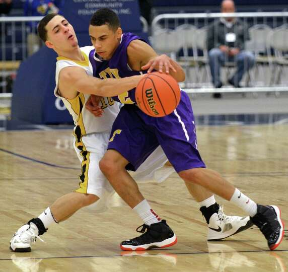 Henninger's Franky Vigliotti, left, fouls Troy's Jordan Nelson during the fourth quarter of the boys