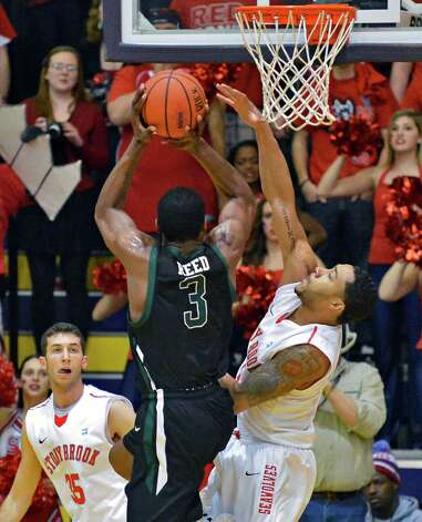 Binghamton's #3 Jordan Reed shoots as Stony Brook's #1 Ron Bracey defends during their America East tournament game Saturday March 9, 2013. (John Carl D'Annibale / Times Union) Photo: John Carl D'Annibale / 10021442A