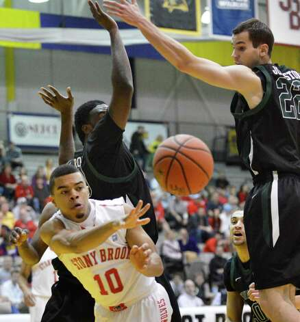 Stony Brook's #10 Carson Puriefoy, left, gets a pass around Binghamton defenders during their America East tournament game Saturday March 9, 2013. (John Carl D'Annibale / Times Union) Photo: John Carl D'Annibale / 10021442A