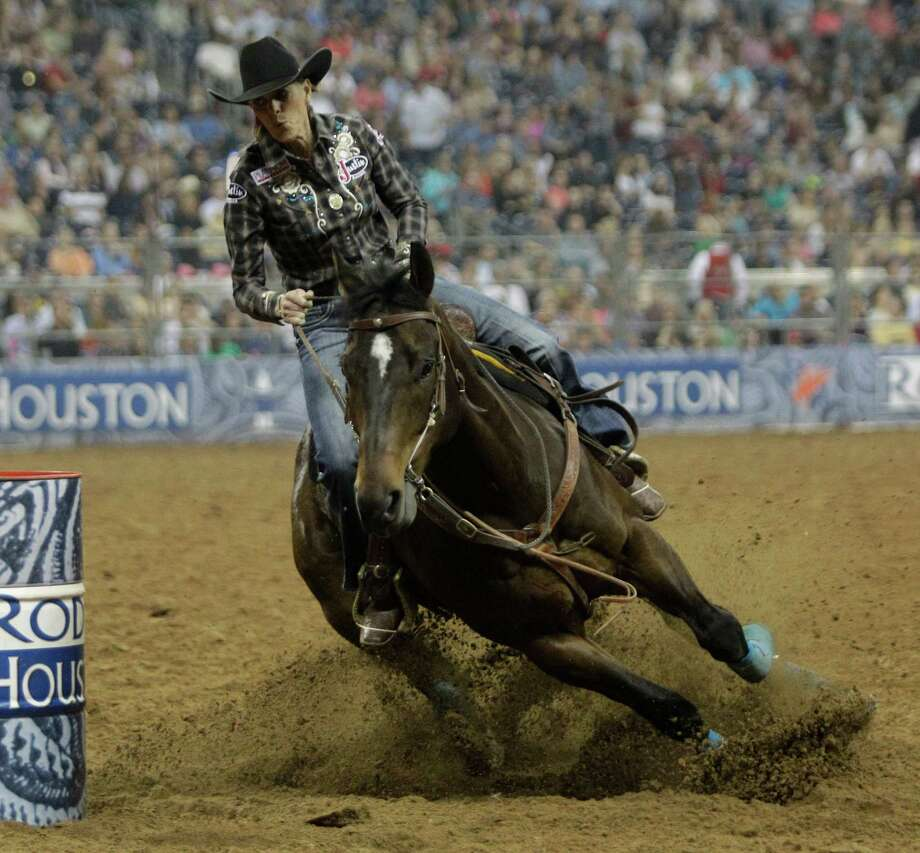 Mary Walker and Latte work through the barrels on their to a victory in the RodeoHouston Super Shootout at Reliant Stadium on Saturday. Photo: Melissa Phillip, Staff / © 2013  Houston Chronicle