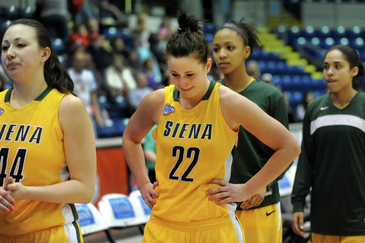 Siena's Lily Grenci (22), center, reacts when they lose to Iona 68-58 in their semifinal MAAC Championship basketball game on Saturday, March 9, 2013, at MassMutual Center in Springfield, Mass. (Cindy Schultz / Times Union)