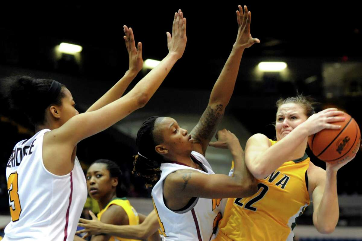 Siena's Lily Grenci (22), right, struggles against the defense of Iona's Sabrina Jeridore (3), left, and Joy Adams (24) during their semifinal MAAC Championship basketball game on Saturday, March 9, 2013, at MassMutual Center in Springfield, Mass. (Cindy Schultz / Times Union)