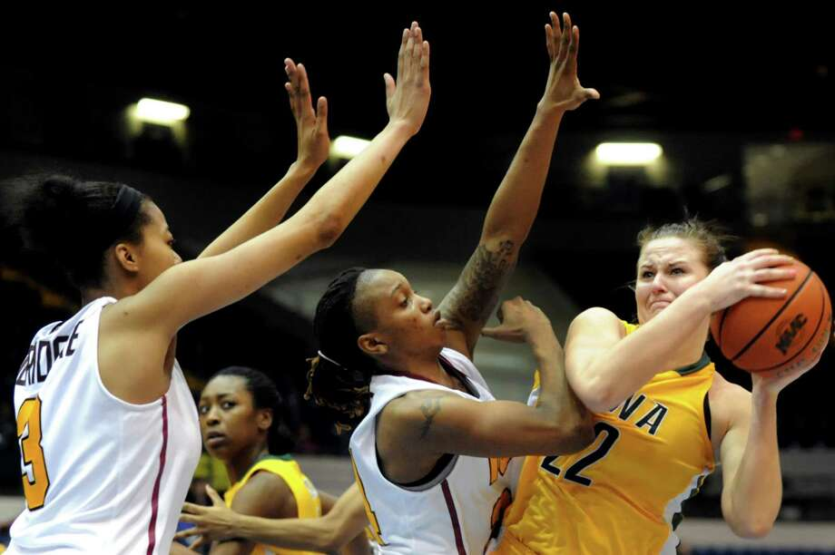 Siena's Lily Grenci (22), right, struggles against the defense of Iona's Sabrina Jeridore (3), left, and Joy Adams (24) during their semifinal MAAC Championship basketball game on Saturday, March 9, 2013, at MassMutual Center in Springfield, Mass. (Cindy Schultz / Times Union) Photo: Cindy Schultz / 10021492A