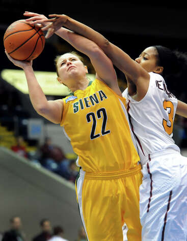 Siena's Lily Grenci (22), left, shoots for the hoop and draws a foul from Iona's Sabrina Jeridore (3) during their semifinal MAAC Championship basketball game on Saturday, March 9, 2013, at MassMutual Center in Springfield, Mass. (Cindy Schultz / Times Union) Photo: Cindy Schultz / 10021492A