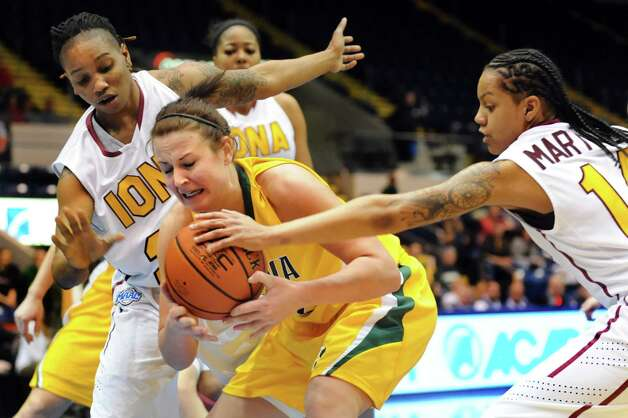 Siena's Lily Grenci (22), center, struggles for the ball against  Iona's Joy Adams (24), left, and Damika Martinez (14) during their semifinal MAAC Championship basketball game on Saturday, March 9, 2013, at MassMutual Center in Springfield, Mass. (Cindy Schultz / Times Union) Photo: Cindy Schultz / 10021492A