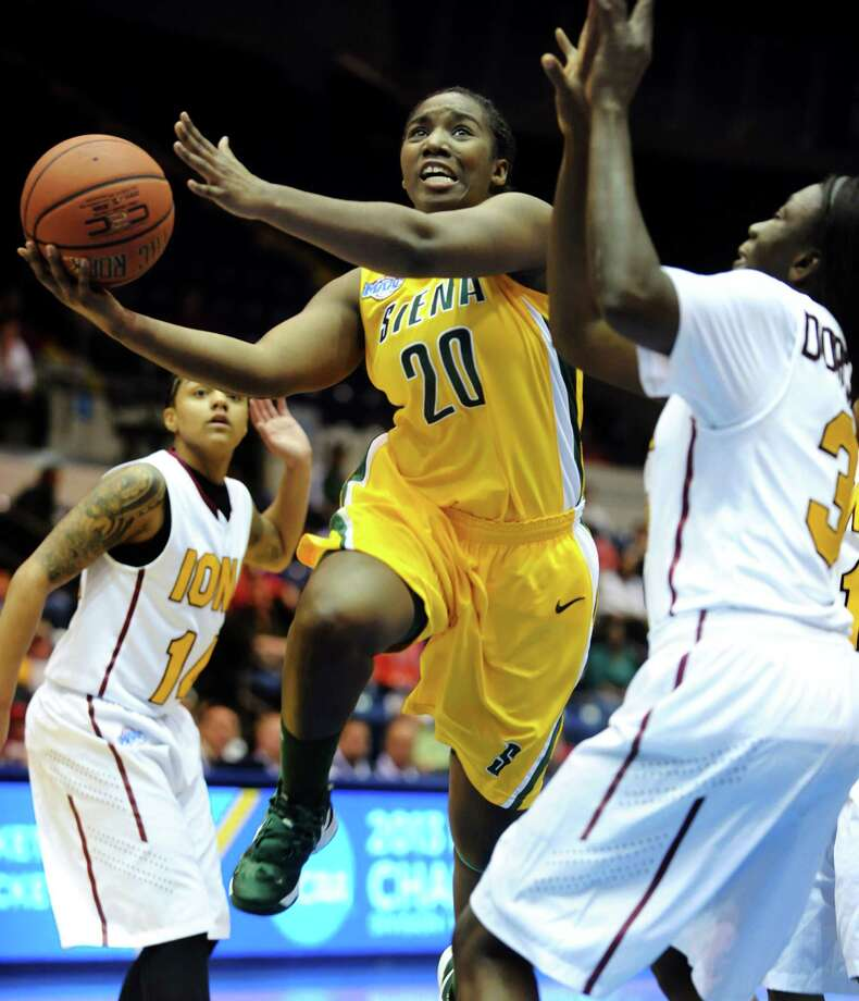 Siena's Kanika Cummings (20), center, goes to the hoop between Iona's Damika Martinez (14), left, and Jiya Dorcas-Eya (31) during their semifinal MAAC Championship basketball game on Saturday, March 9, 2013, at MassMutual Center in Springfield, Mass. (Cindy Schultz / Times Union) Photo: Cindy Schultz / 10021492A