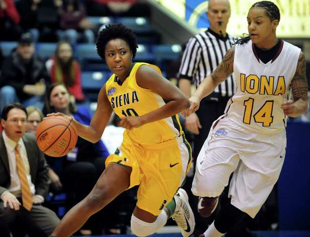 Siena's Allison Mullings (10), left, controls the ball as Iona's Damika Martinez (14) defends during their semifinal MAAC Championship basketball game on Saturday, March 9, 2013, at MassMutual Center in Springfield, Mass. (Cindy Schultz / Times Union) Photo: Cindy Schultz / 10021492A