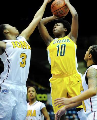 Siena's Allison Mullings (10), center, goes to the hoop as Iona's Sabrina Jeridore (3) defends during their semifinal MAAC Championship basketball game on Saturday, March 9, 2013, at MassMutual Center in Springfield, Mass. (Cindy Schultz / Times Union) Photo: Cindy Schultz / 10021492A