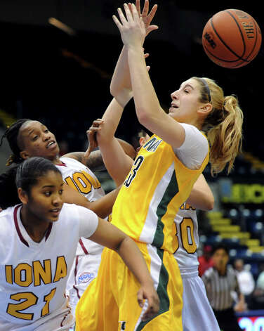 Siena's Kate Zarotney (23), right, goes for a loose ball against Iona's Aaliyah Robinson (21), left, and Joy Adams (24) during their semifinal MAAC Championship basketball game on Saturday, March 9, 2013, at MassMutual Center in Springfield, Mass. (Cindy Schultz / Times Union) Photo: Cindy Schultz / 10021492A