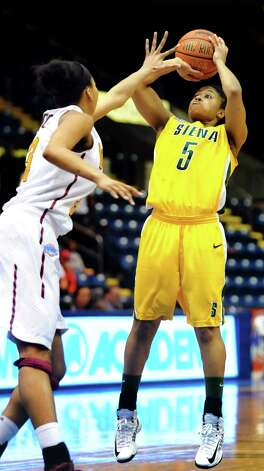 Siena's Ciara Stewart (5), right, shoots for the hoop as Iona's  Sabrina Jeridore (3) defends during their semifinal MAAC Championship basketball game on Saturday, March 9, 2013, at MassMutual Center in Springfield, Mass. (Cindy Schultz / Times Union) Photo: Cindy Schultz / 10021492A