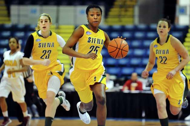 Siena's Tehresa Coles (25), center, flanked by Kate Zarotney (23), left, and Lily Grenci (22), drive up court during their semifinal MAAC Championship basketball game against Iona on Saturday, March 9, 2013, at MassMutual Center in Springfield, Mass. (Cindy Schultz / Times Union) Photo: Cindy Schultz / 10021492A