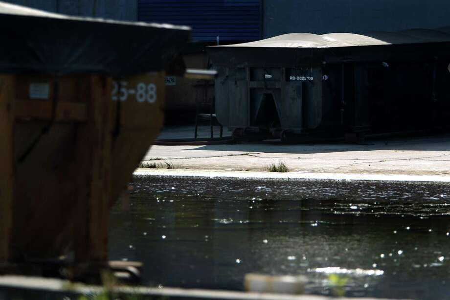 "Hazardous materials can seep out of containers and into water sources on Thursday, March 7, 2013, in Pasadena. The containers have been abandoned by a businessman who conducted fraudulent ""oil recycling"" business left a huge superfund site in Pasadena, and he skipped town. Photo: Mayra Beltran, Houston Chronicle / © 2013 Houston Chronicle"