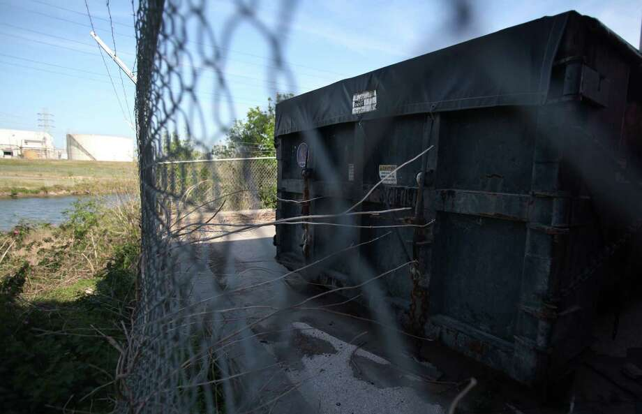 """Hazardous materials can seep out of containers and into water sources such as the local bayou on Thursday, March 7, 2013, in Pasadena. The containers have been abandoned by a businessman who conducted fraudulent """"oil recycling"""" business left a huge superfund site in Pasadena, and he skipped town. Photo: Mayra Beltran, Houston Chronicle / © 2013 Houston Chronicle"""