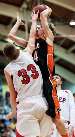 Tim Butala, Fairfield Prep, tries to block a shot by Ridgefield high school's Kurt Steidl in a quarterfinal round 2013 CIAC class LL boys basketball tournament game held at Alumni Hall, Fairfield University, Fairfield CT on Saturday March 9th 2013. Photo: Mark Conrad / Connecticut Post Freelance